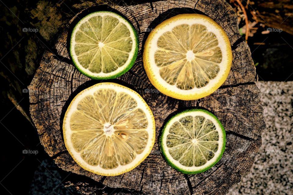 Lemons And Limes On A Log, Food Portrait, Healthy Eating, Farm Fresh Foods, Fruits On Display