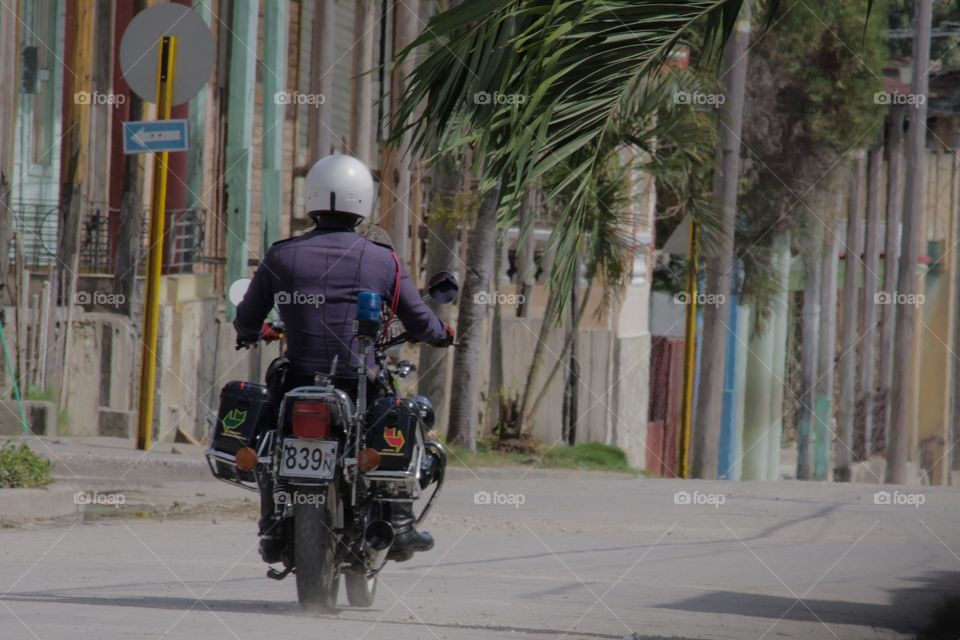 Cuban People.Motorcycle Cop