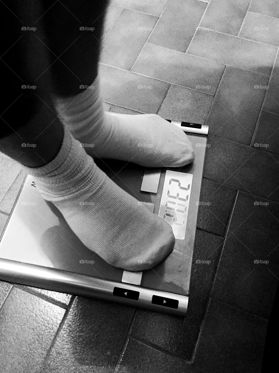 First day on a diet...feet on a scale with weight in imperial pounds