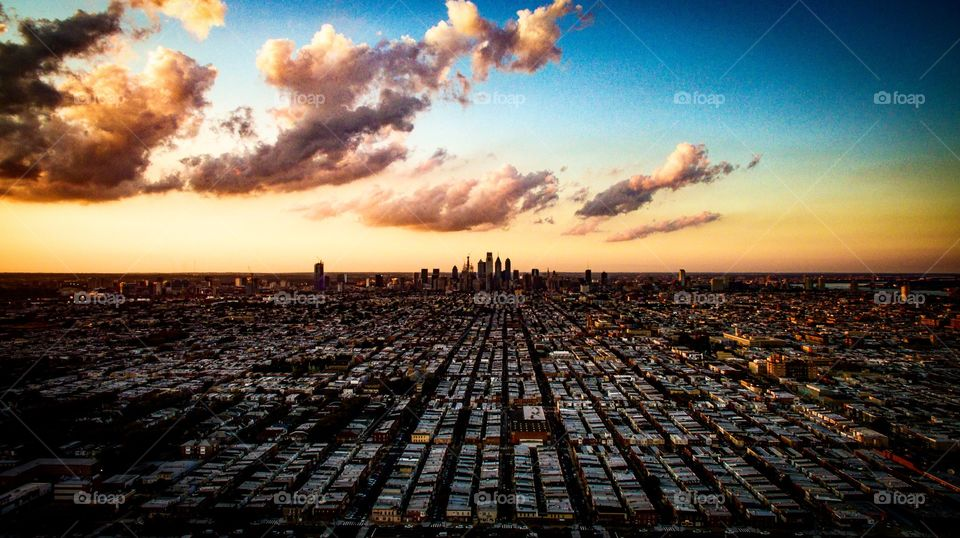 Drone shot of Philly skyline during sunset