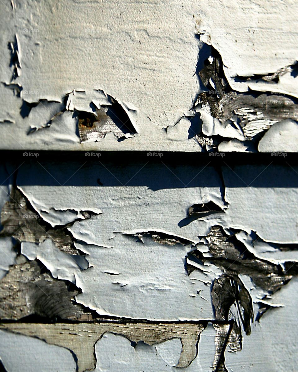 Cracking paint on wooden fence