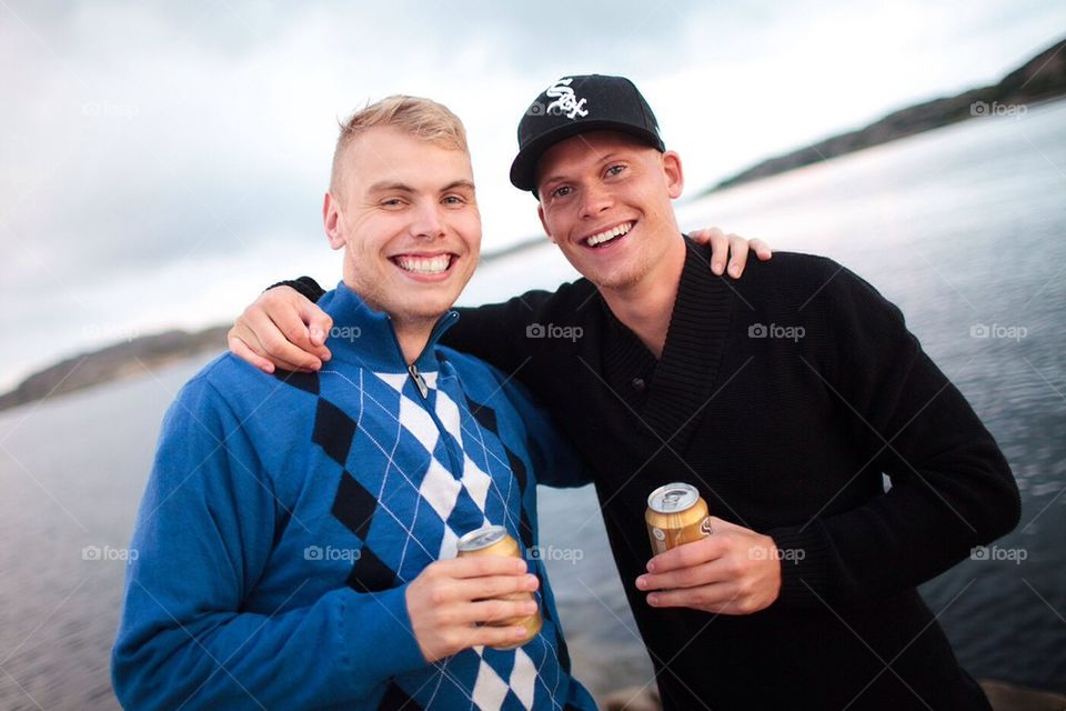 Two friends holding eachother and smiling