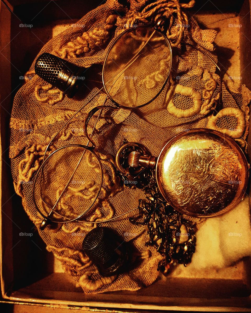 Vintage treasures..pocket watch, thimble and glasses