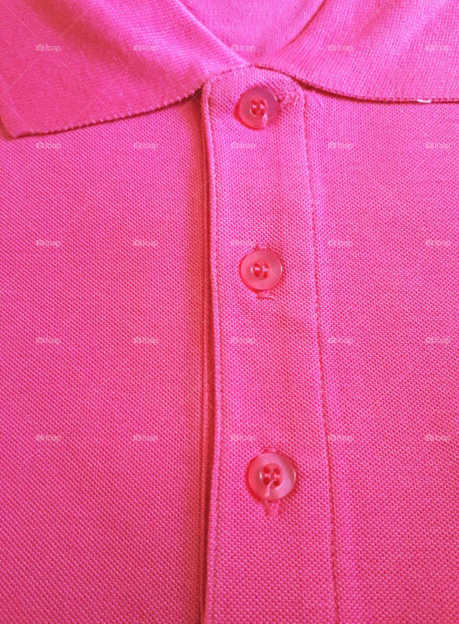 A folded pink shirt