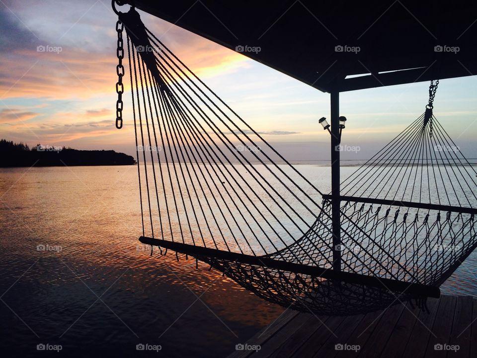 Hammocks on the dock at sea