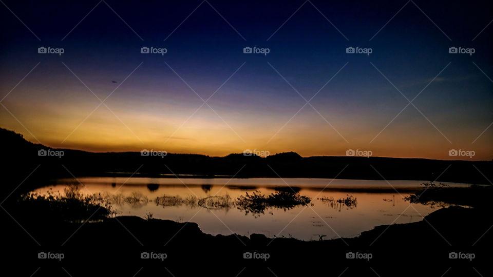 beautyfull sunset behid the mountains beautyfull colourfull view on sky & water