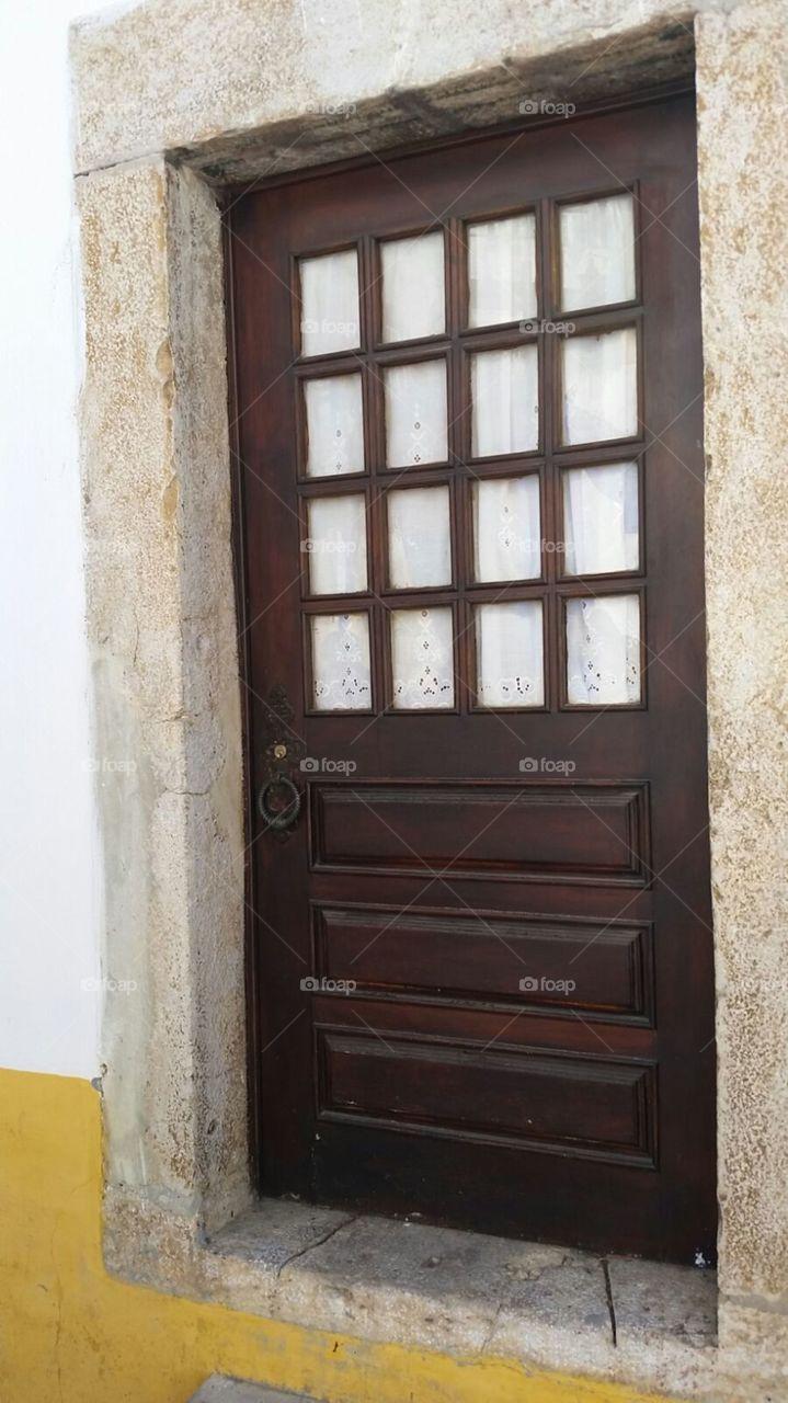 Brown door in old house  at Obidos