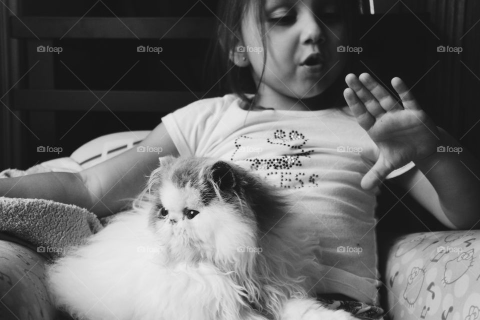 Girl sitting with a cat