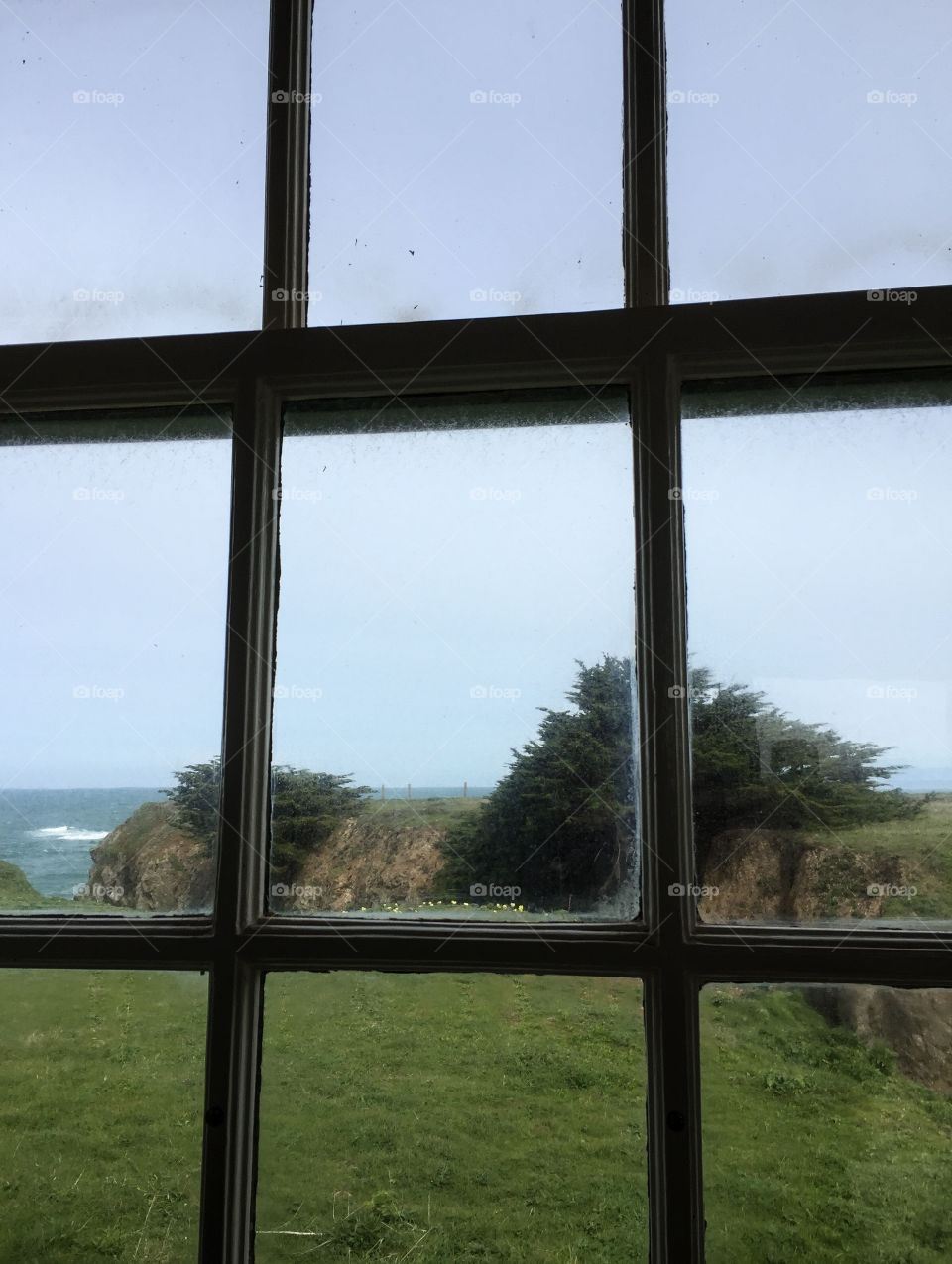 Outside the window, landscape of a coastal view.