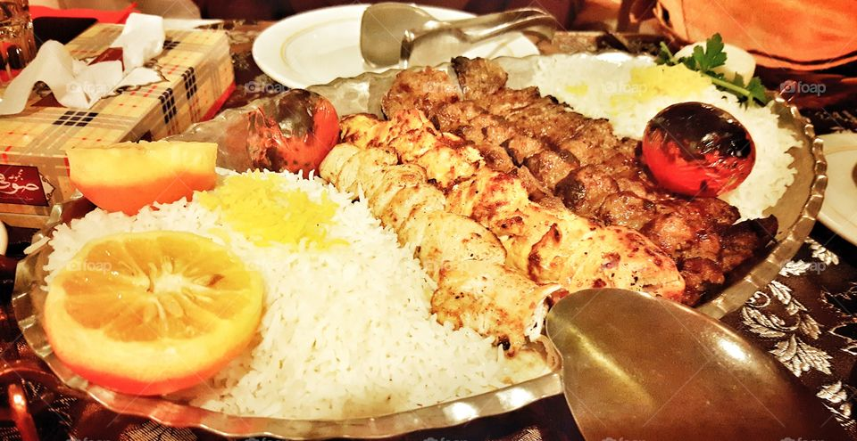 Persian grill, chicken and veal kebab with saffron rice and grilled tomatoes