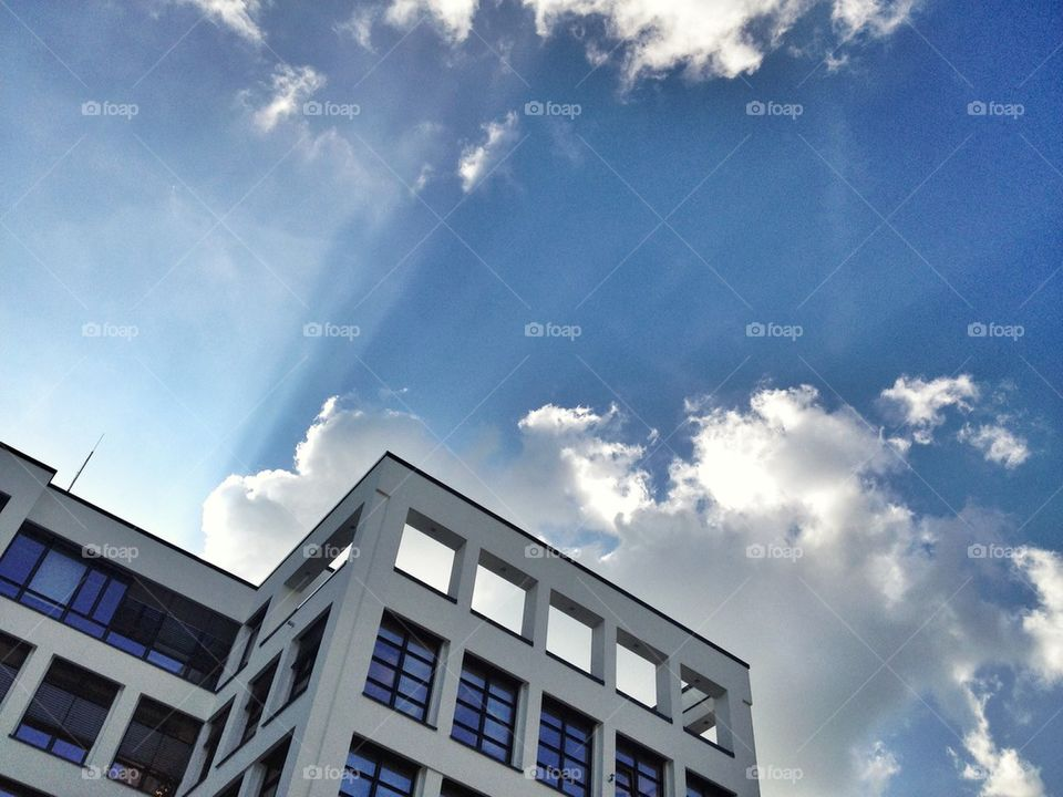 Office building with dramatic sky