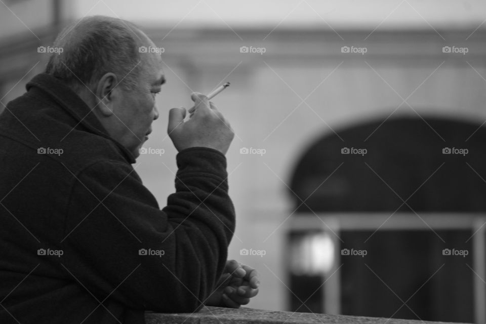 Thinking man smoking a cigarette