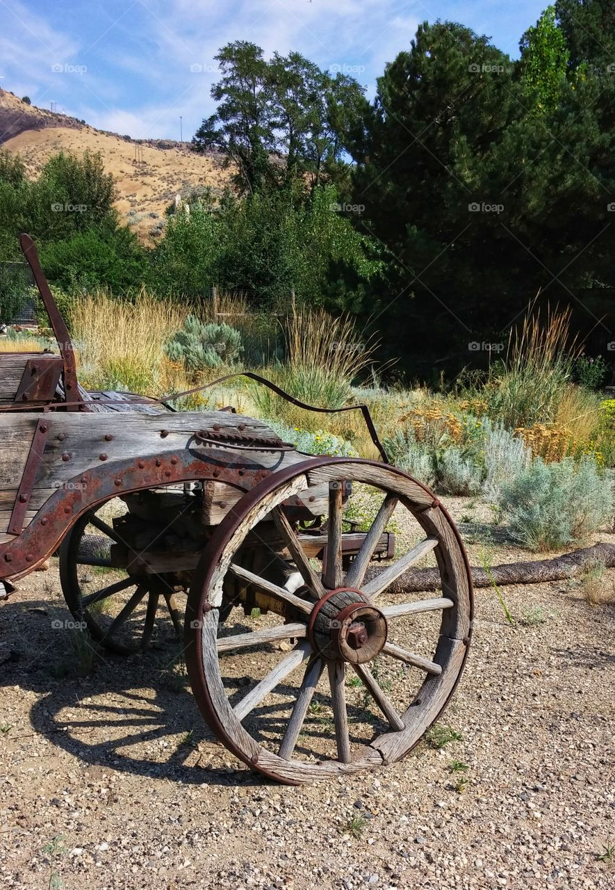 This photo is of the front end of an authentic old Western Wagon that used to be pulled by a horse or horses. It is located at the base of Boise's foothills, near the old Idaho State Penitentiary.