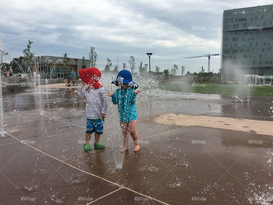 Children playing in the fountain in downtown Charlotte