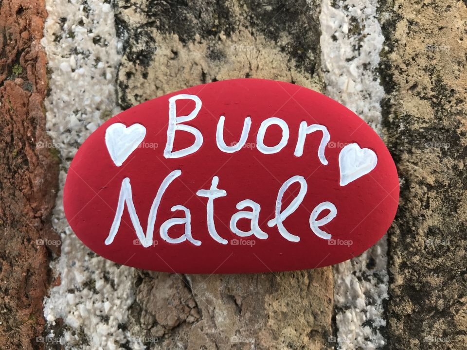 Buon Natale, italian Merry Christmas on a stone