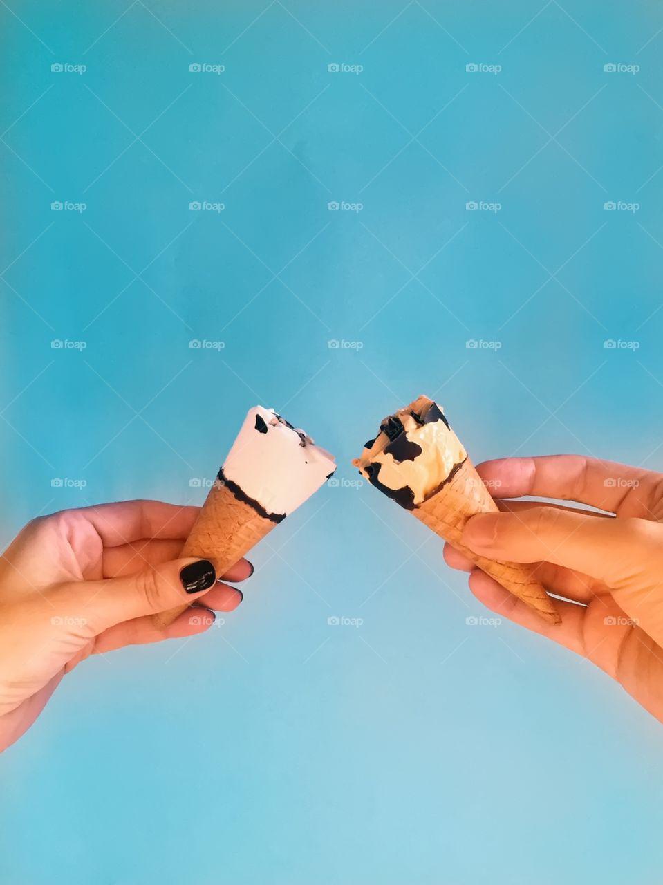 Woman hand holding an ice cream cone