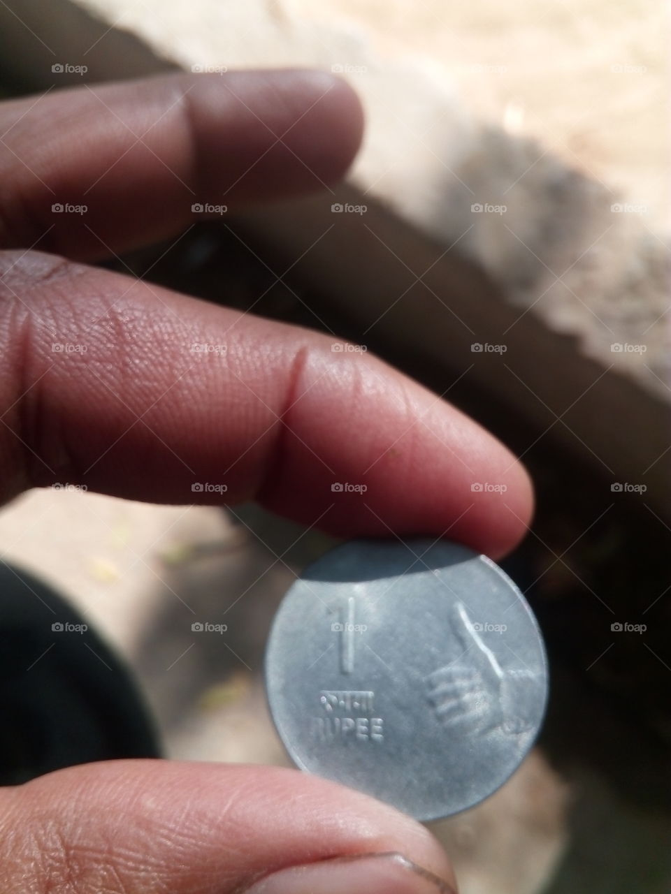 coin with hand