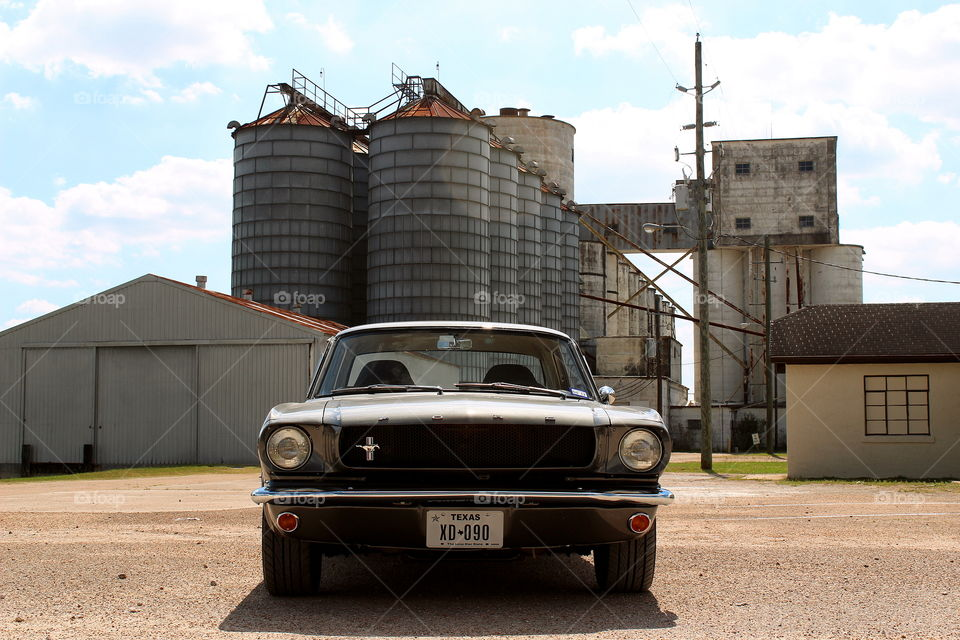 1965 ford Mustang industrial setting, american classic muscle car