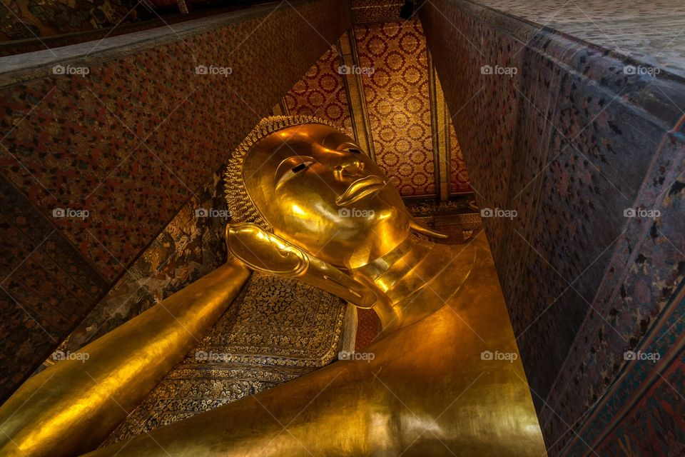 Close-up of gold coloured buddha statue