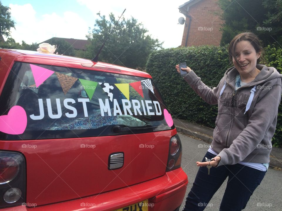 Just married car and bride