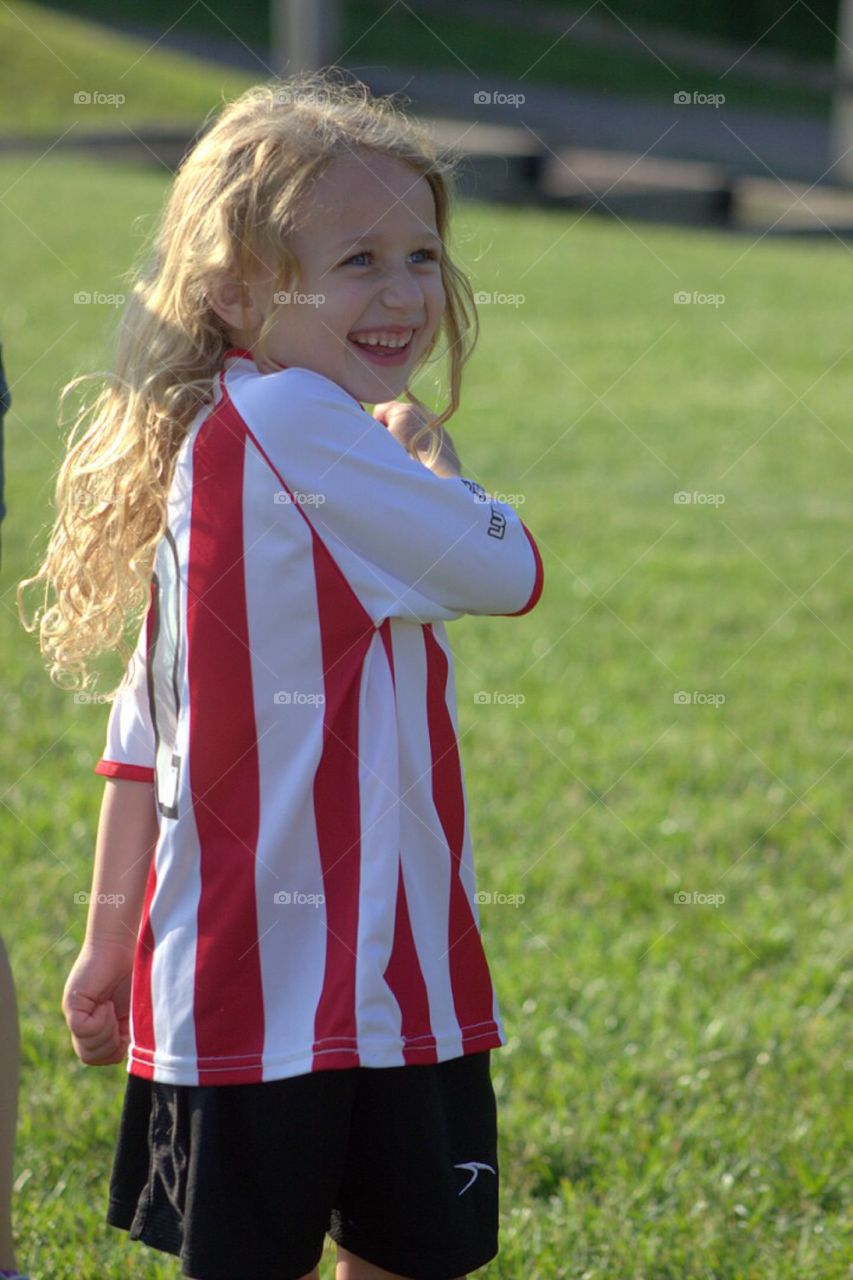 Little cute girl in sports clothing