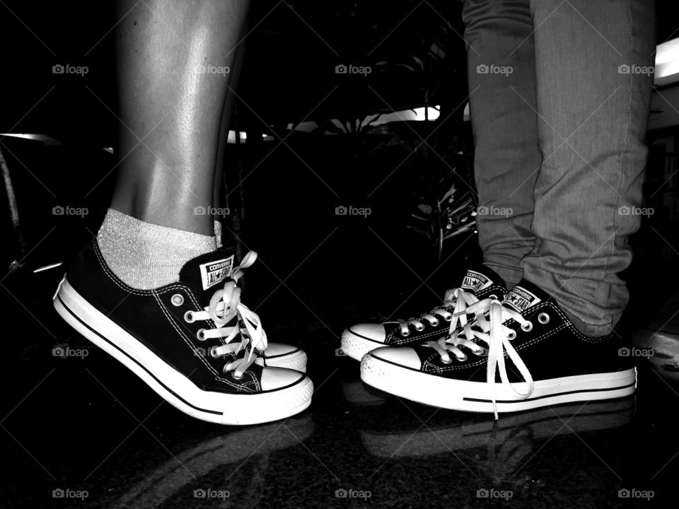 Converse Lovers. Two of my good friends wearing their converse to the club.