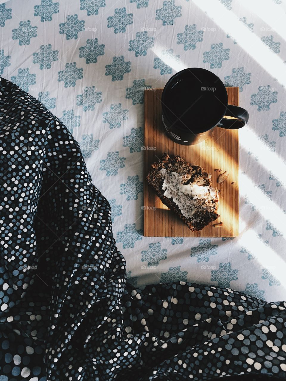 Coffee and banana bread on the bed.