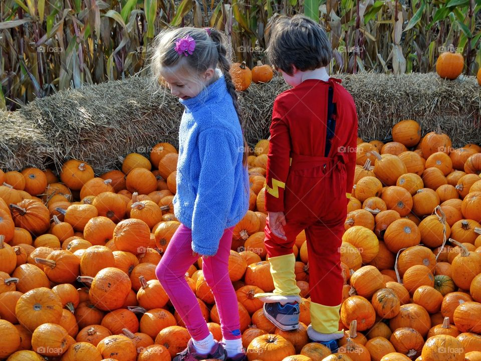 Boy And Girl In The Pumpkin Patch