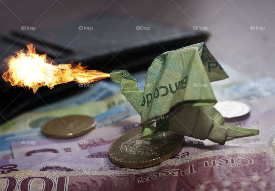 Don't mess with my wallet! I recently decided to combine two of my favorite arts: Origami and photography. After I took this shot I decided my little dragon needed a little fire. Now I have a fire breathing dragon protecting my wallet.