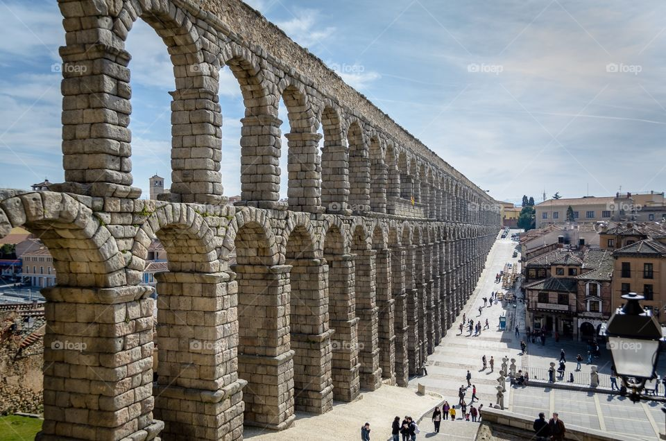 Impressive Roman aqueduct in the middle of Segovia city, Spain