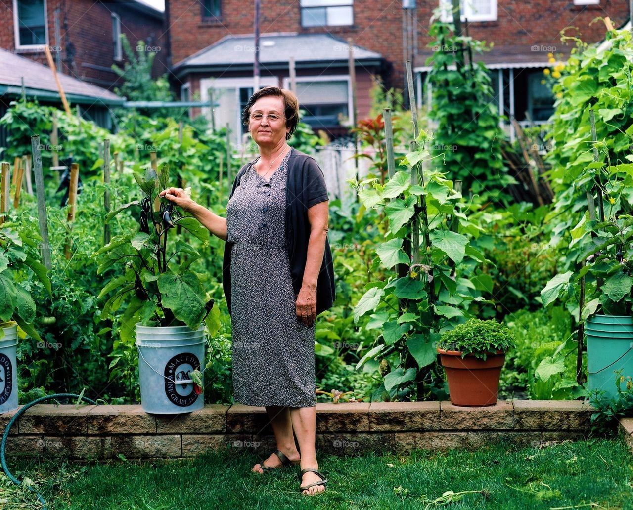 Captivating Grandmau0027s Garden. Proud Grandmother With Her Urban Organic Veg Garden