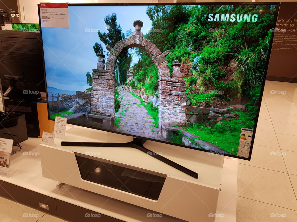 Samsung UE65NU7400 4K UHD television on white TV stand at Peter Jones Sloane square Chelsea King's road London