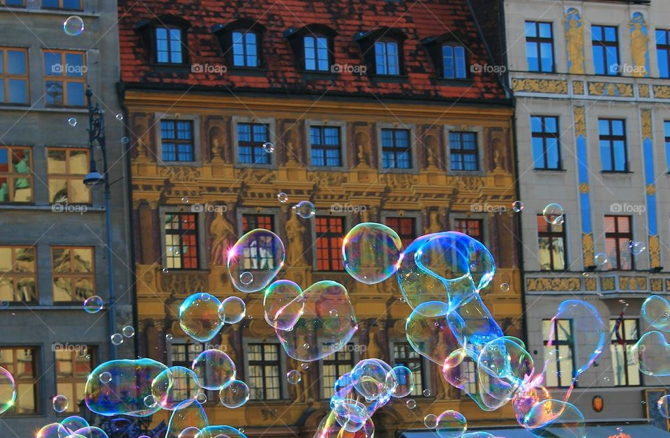 Bubbles floating in front of building