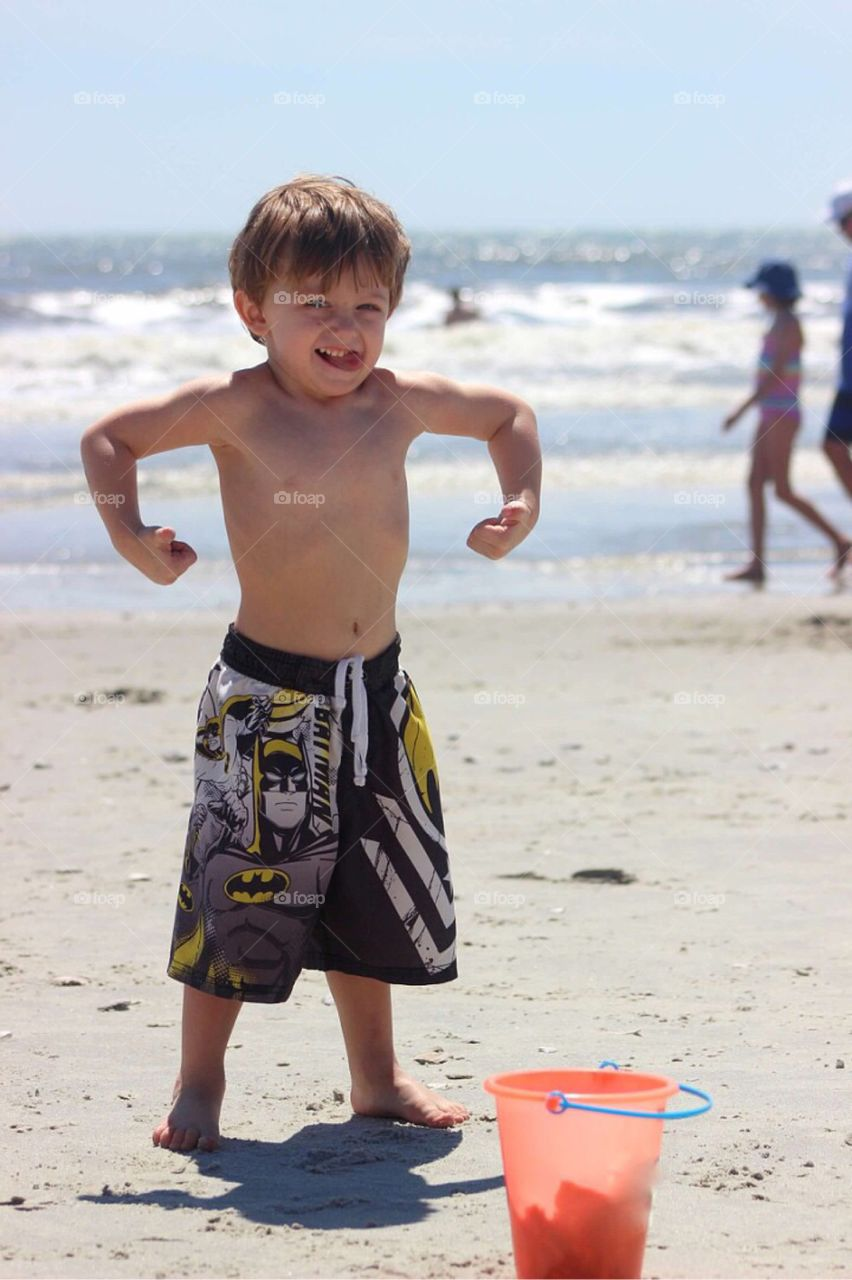 Small little boy posing at beach