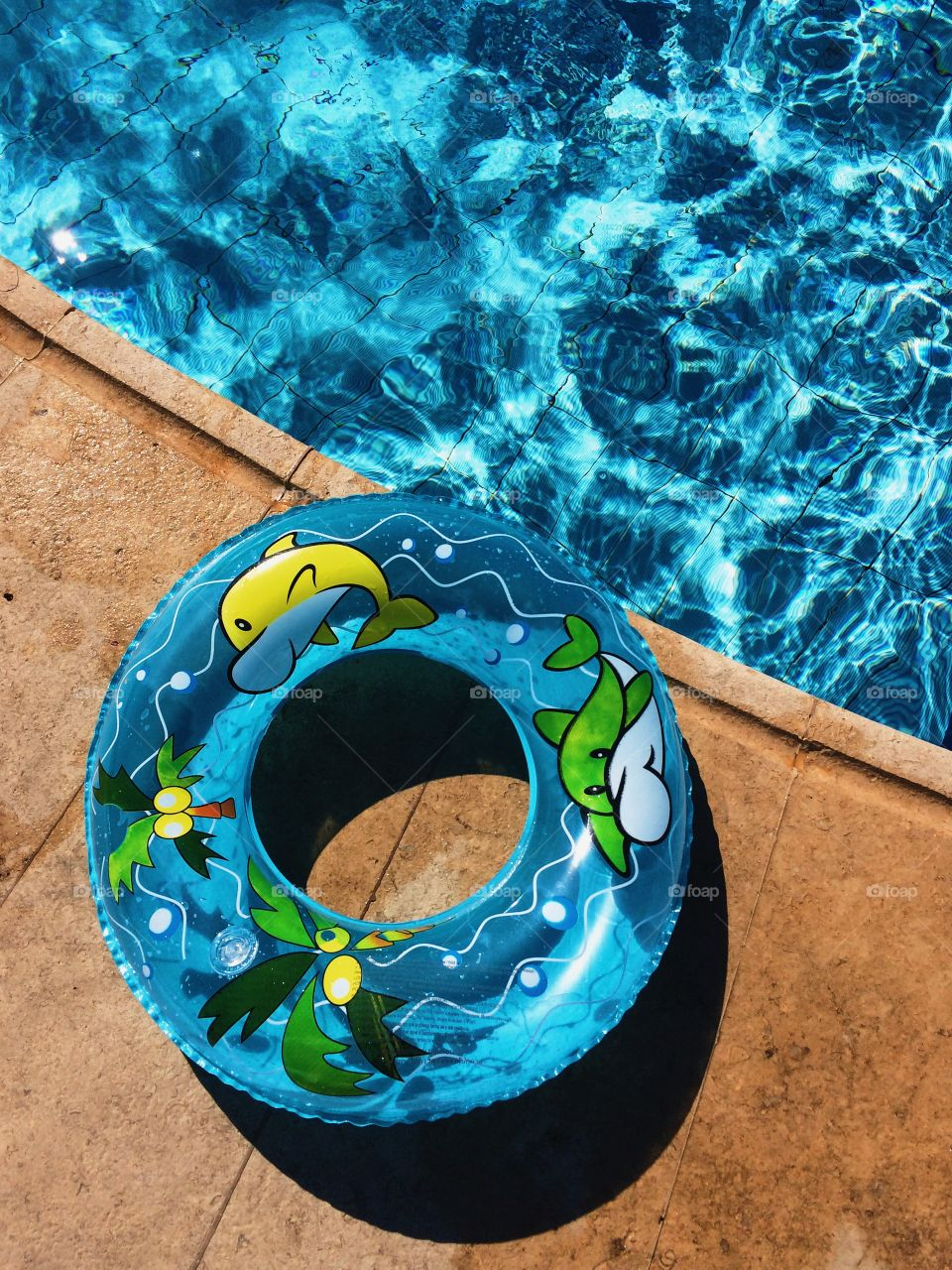 Blue inflatable ring near swimming pool