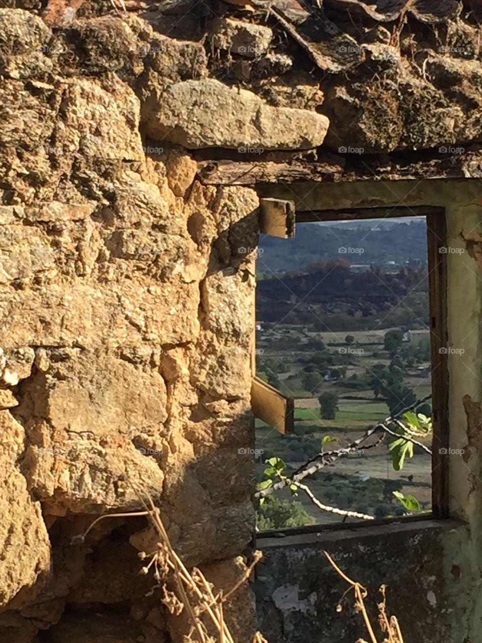 Belmonte view through old wall window