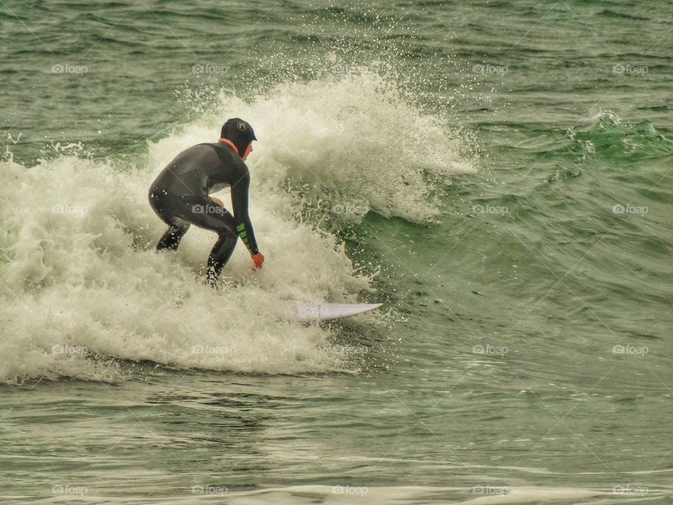 Surfer In Cold Water. California Surfing