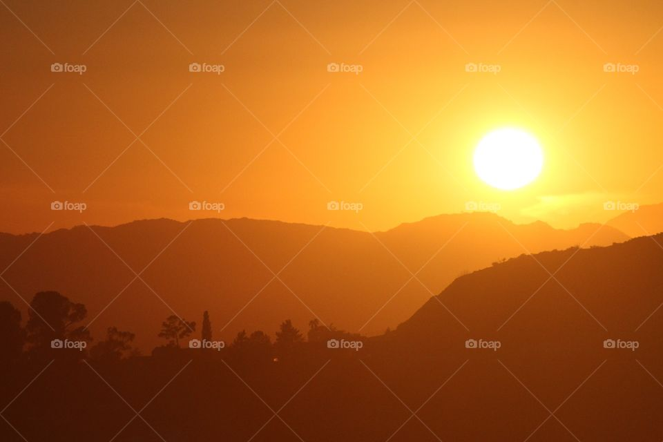 Los Angeles Sunsets. the view of an orange haze sunset from the Griffith Observatory