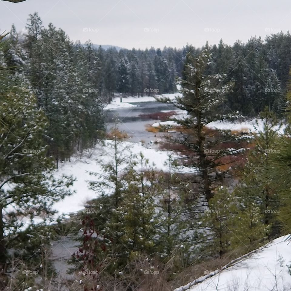 view of a flowing snowy river