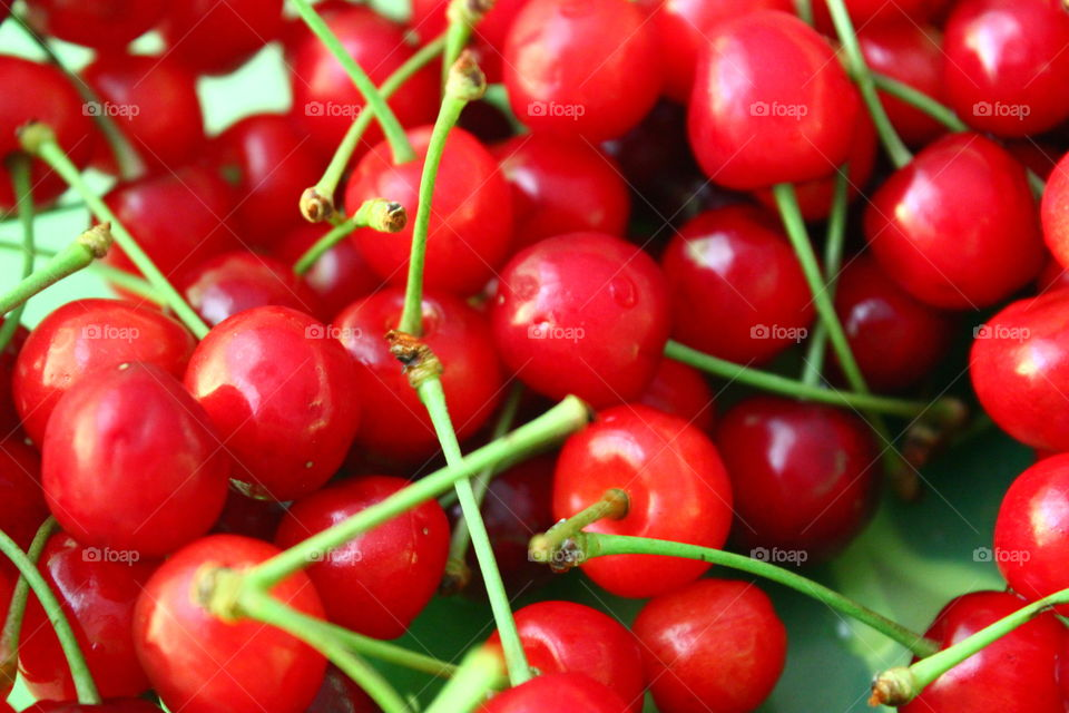 a lot of cherries in plate