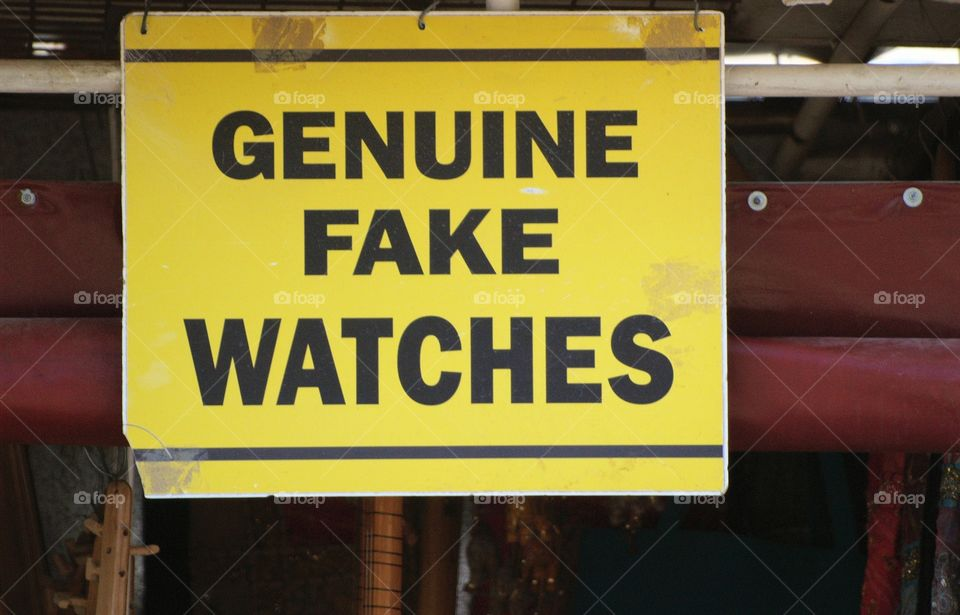 """A sign  at the market in Ephesus, Turkey advertising """"Genuine Fake Watches"""""""