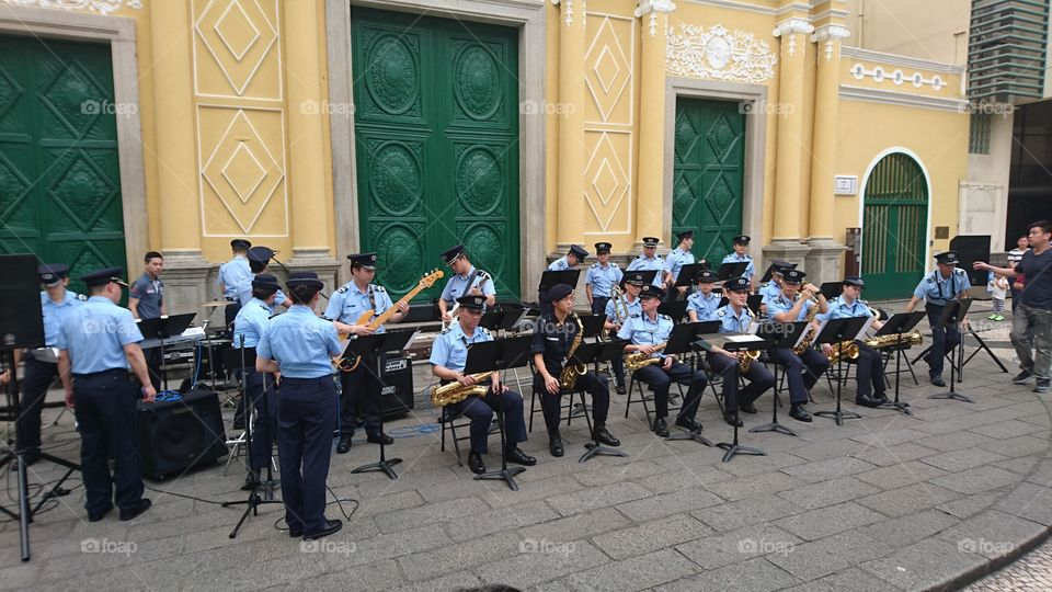 a Macau policemen and women orchestra in their free public concert/appearance as part for tourism promotion. this was held Sanmalo, a center of Macau outside the St Dominique Church, one among the Landmark.