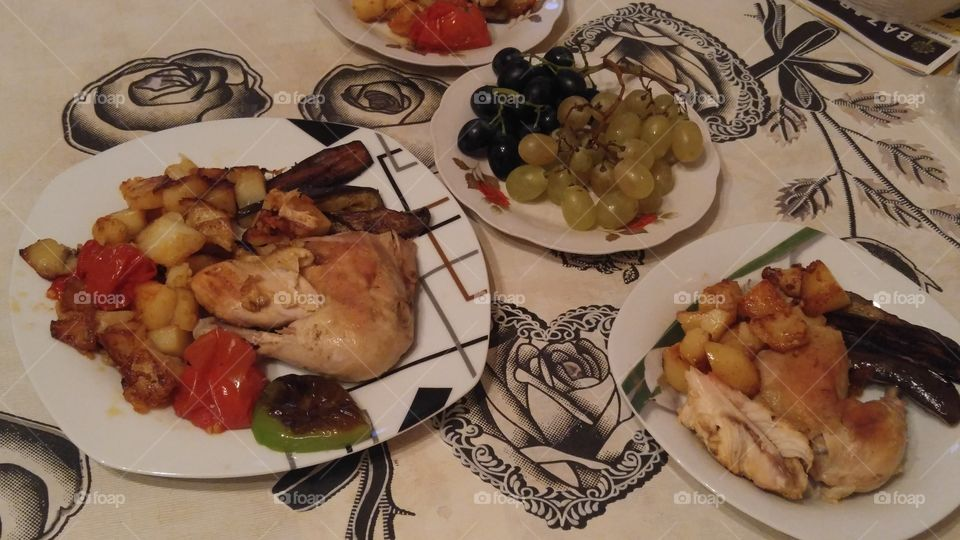 For lunch-chicken, potatoes, tomatoes and grapes.