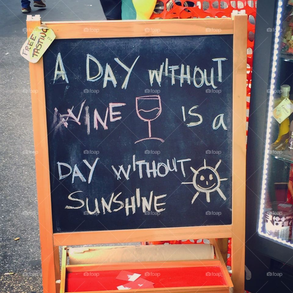 Wine = Sunshine. An funny quote outside of a restaurant in Rome, Italy