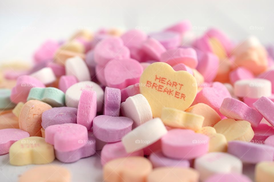 Pile of Valentine's Candy Hearts on a White Background