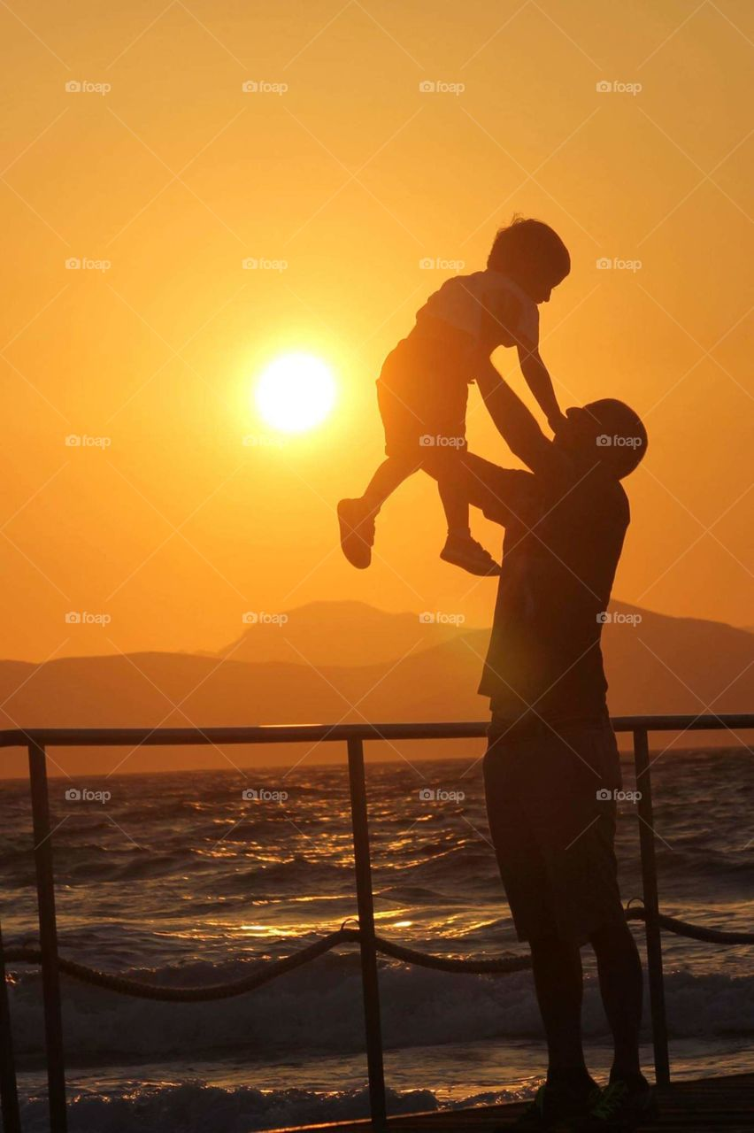 #dad and son #family #happy moments #play #sea #sunset #happiness