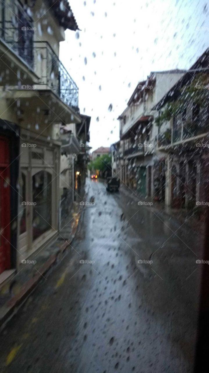 Road and houses in rainy season