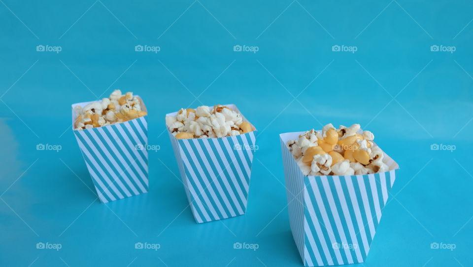 Popcorn boxes on blue background