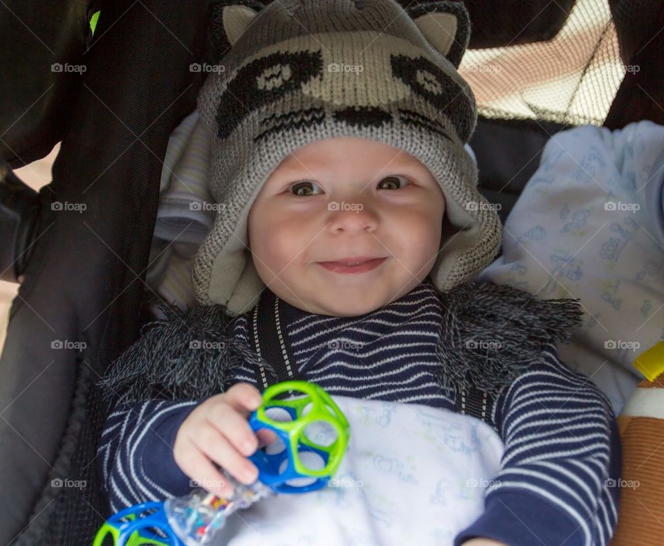 Carter and his adorable Raccoon Hat