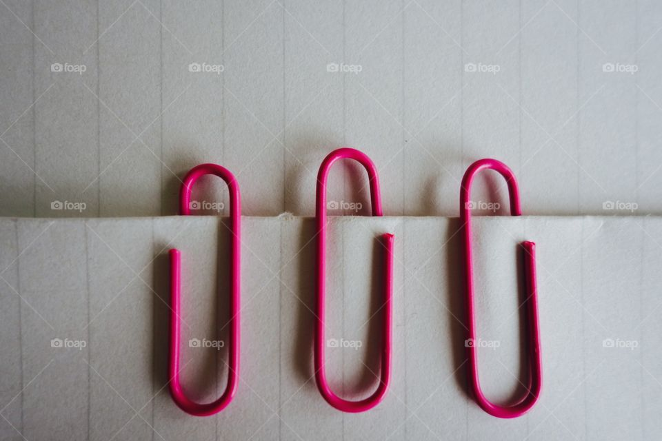 Pink clips on paper